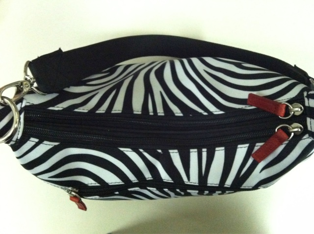 Top View of Two Main Compartments with Splash of Red on Zippers