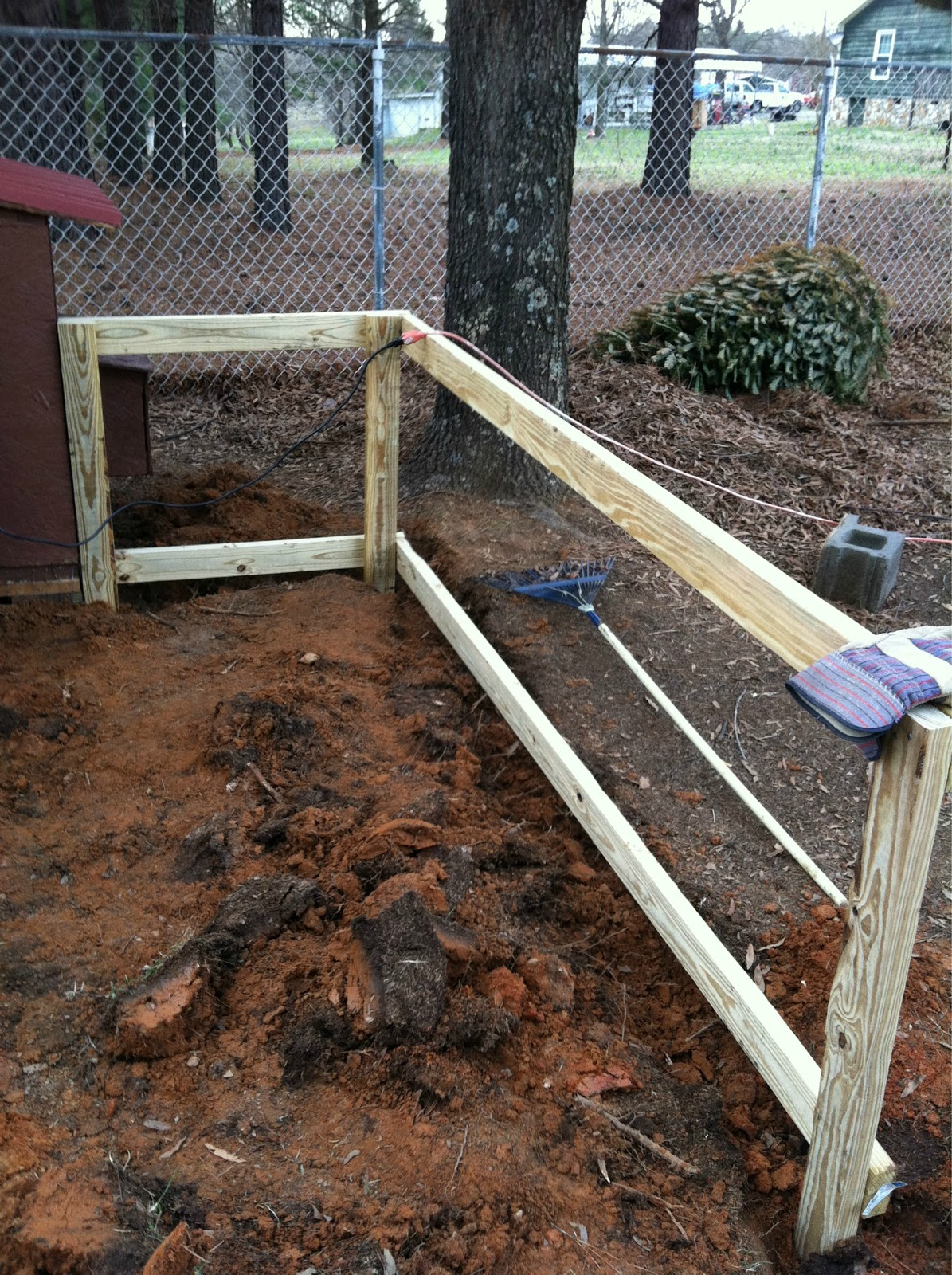 Building the chicken run summers acres - Build wire fence foundation ...
