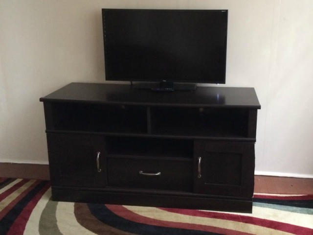 New Outlet Behind Entertainment Center