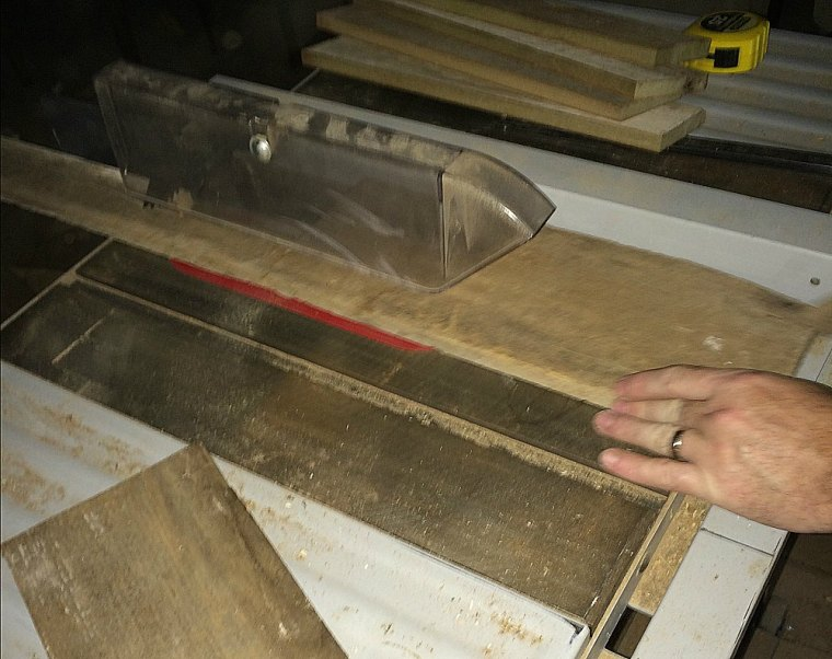Cutting Weathered Wood to Be Re-purposed for Signs